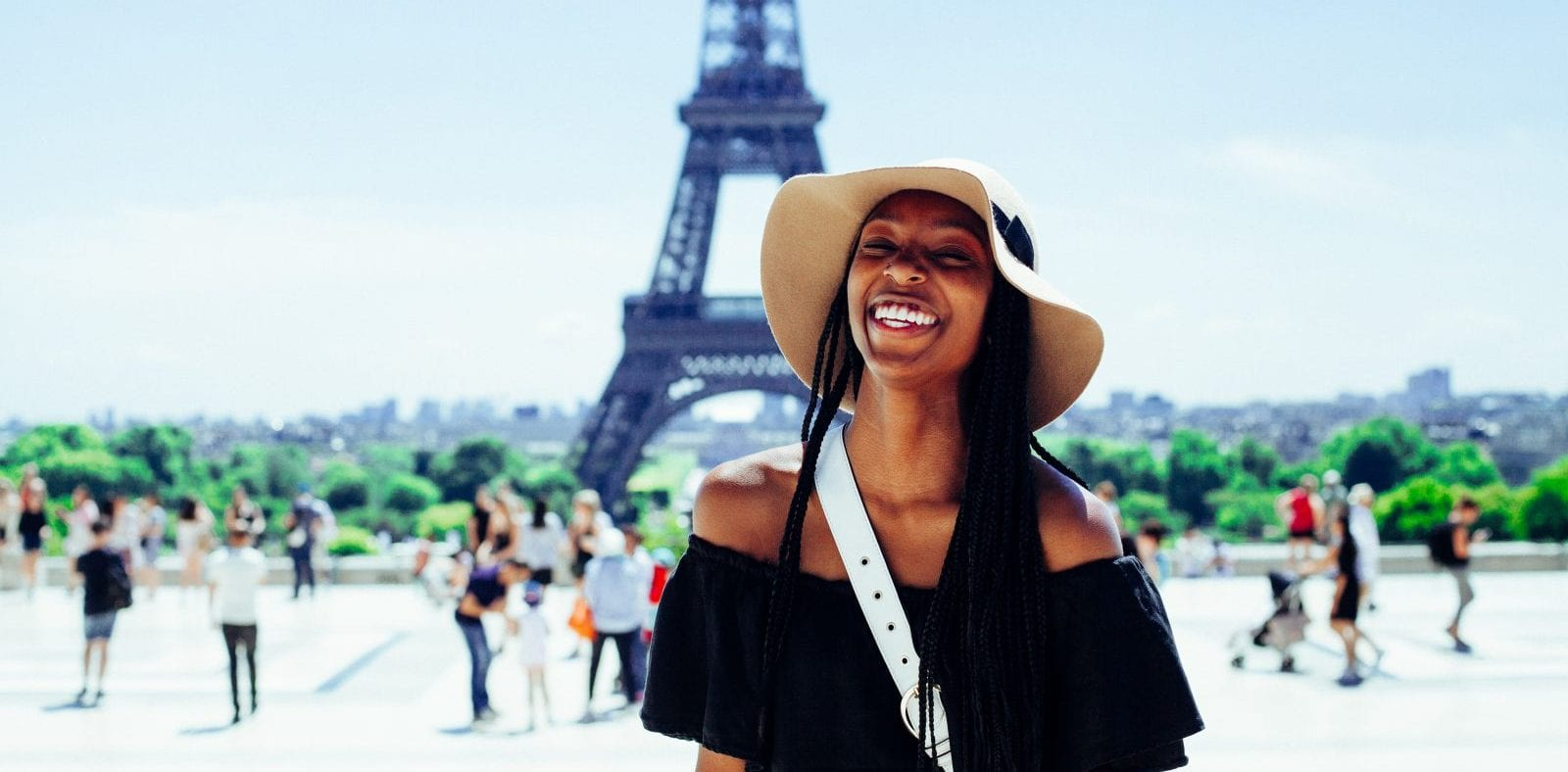 woman standing outside Eiffel tower